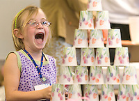 NEWS&GUIDE PHOTO / PRICE CHAMBERS.Rachael Harrower, 5, reacts to the completion of her Dixie Cup castle during the first day of Mrs. Lewis' kindergarten class at Jackson Hole Elementary.