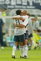 Landon Donovan is embraced by Earnie Stewart after scoring the team's second goal. The USA defeated Mexico 2-0 in the Round of 16 of the FIFA World Cup 2002 in South Korea on June 17, 2002.