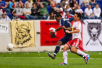 Sherjill MacDonald (7) of the Chicago Fire shoots and scores beating Heath Pearce (3) of the New York Red Bulls. The Chicago Fire defeated the New York Red Bulls 2-0 during a Major League Soccer (MLS) match at Red Bull Arena in Harrison, NJ, on October 06, 2012.