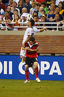 7 June 2011: USA Men's National Team forward Clint Dempsey (8) heads the ball over Canada midfielder Will Johnson (8) during the CONCACAF soccer match between USA MNT and Canada MNT at Ford Field Detroit, Michigan. USA won 2-0.