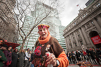 Urban Shaman Donna Henes blesses with water at her  39th Annual Eggs on End:  Vernal Equinox Celebration in Bowling Green Park in New York welcoming in the first day of spring on Thursday, March 20, 2014.  At the precise moment of the Spring Equinox, this year at 12:57 PM, a raw egg can be stood on its end bringing good luck for the rest of the year and dozens of participants were glad to see winter go at the ceremony. Henes has been organizing this event for 39 years. (© Richard B. Levine)