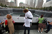 On the 10th anniversary of the September 11th attacks, family members at the South Memorial Pool at opening day of the September 11th Memorial at the World Trade Center site in New York, New York on Sunday, September 11, 2011..Credit: Jefferson Siegel / Pool via CNP