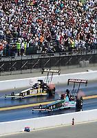 Jul. 18, 2010; Sonoma, CA, USA; NHRA top fuel dragster driver Terry McMillen (near) races Tony Schumacher during the Fram Autolite Nationals at Infineon Raceway. Mandatory Credit: Mark J. Rebilas-