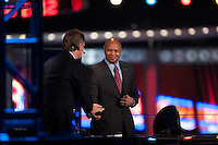 Stanford head coach David Shaw shakes hands with NFL Network analyst Brian Billick during the 2012 NFL Draft at Radio City Music Hall in New York, NY, on April 26, 2012.
