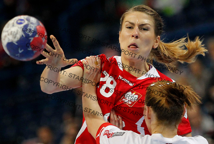 BELGRADE, SERBIA - DECEMBER 22: Alina Wojtas (L) of Poland is challenged by  Marianne Bonde Pedersen (R) of Denmark during the World Women's Handball Championship 2013 Bronze medal match between Denmark and Poland at Kombank Arena Hall on December 22, 2013 in Belgrade, Serbia. (Photo by Srdjan Stevanovic/Getty Images)