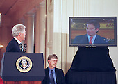 United States President Bill Clinton watches British Prime Minister Tony Blair speak from London at the announcement of the completion of the first survey of the entire Human Genome at the White House in Washington, DC on June 26 , 2000. Doctor Francis Collins, Director, National Institutes of Health (NIH)  is seated at center.<br /> Credit: Ron Sachs / CNP