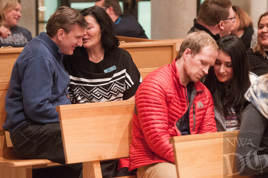 NWA Democrat-Gazette/ANTHONY REYES &bull; @NWATONYR<br /> Tom Peters, from left, with his wife Karen Peters and Gabe Parrill with his wife Brenda Parrill, participate in an excercise Friday, Jan. 8, 2016 at the end of a session with Allen Hunt at St. Vincent de Paul Catholic Church in Rogers. Hunt is with the Dynamic Catholic organization and his talk, &quot;Passion and Purpose for Marriage&quot;,  focused on how to make a healthy and happy marriage through faith and understanding your spouse.