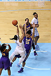 30 December 2014: North Carolina's Allisha Gray (15) shoots over Albany's Tiana-Jo Carter (33). The University of North Carolina Tar Heels hosted the University at Albany Great Danes at Carmichael Arena in Chapel Hill, North Carolina in a 2014-15 NCAA Division I Women's Basketball game. UNC won the game 71-56.
