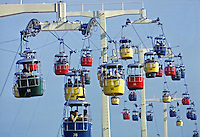 Swiss Sky Ride, 1964 World's Fair, Flushing Meadows New York. The Sky Ride was one of the highest at the Fair, with the colorful cabins suspended 113 feet in the air by cables. The four minute trip provided visitors with panoramic views of the fairgrounds and Manhattan Island. Photo by John G. Zimmerman.