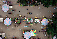 A fruit and vegetables market with colourful umbrellas in the area of Wuming near Nanning. /Felix Features