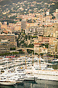 View of world famous harbor and city of with many large yachets.   Monte-Carlo in Monaco.  Coastline of Southern France.