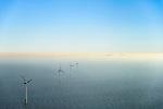 Nederland, Noord-Holland, IJmuiden, 11-12-2013; offshore Prinses Amaliawindpark telt 60 windturbines en is gebouwd door Eneco en Econcern. Het windmolenpark ligt 23 km uit de kust bij IJmuiden (blok Q7 van het Nederlands continentaal plat). Foto richting kust (Wijk aan Zee en Hoogovens / Corus aan de horizon).<br /> The Princess Amalia offshore Wind Farm consists of 60 wind turbines and is located in block Q7 of the Dutch Continental Shelf, 23 km from the shore.<br /> luchtfoto (toeslag op standaard tarieven);<br /> aerial photo (additional fee required);<br /> copyright foto/photo Siebe Swart.