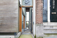 The exterior of architect Francine Houben's contemporary house in Rotterdam contrasts with the more traditional architecture next door.
