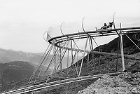 Switzerland. Canton Ticino. Monte Tamaro. Couple on the alpine coaster bobsleigh. Exciting and breathtaking downhill with double bobsleigh on the Alpe Foppa. © 2006 Didier Ruef
