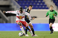Tony Tchani (23) of the New York Red Bulls is marked by Andrew Jacobson (8) of the Philadelphia Union. The New York Red Bulls defeated the Philadelphia Union 2-1 during a US Open Cup qualifier at Red Bull Arena in Harrison, NJ, on April 27, 2010.