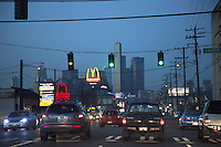 USA. Washington state. Seattle. Downtown. Traffic lights and cars at twilight. Illuminated signs of  the chain of fast food restaurants McDonald's and Arby's. The McDonald's Corporation is the world's largest chain of hamburger fast food restaurants. Arby's Restaurant Group, Inc. is the second largest quick-service sandwich chain in the U.S. 13.12.2014 © 2014 Didier Ruef