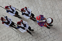 View from above of the City Guards marching in the street, led by a drummer, Old Town, Dubrovnik, Croatia. The city developed as an important port in the 15th and 16th centuries and has had a multicultural history, allied to the Romans, Ostrogoths, Byzantines, Ancona, Hungary and the Ottomans. In 1979 the city was listed as a UNESCO World Heritage Site. Picture by Manuel Cohen
