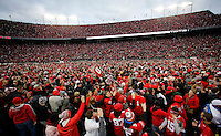 Ohio State Buckeyes fans rush the field after the 30-27 double overtime win over Michigan Wolverines at Ohio Stadium in Columbus, Ohio on November 26, 2016.  (Kyle Robertson / The Columbus Dispatch)