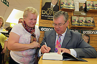 NO FEE PICTURES.15/10/11 Eason, Ireland's leading retailer of books, stationery, magazines and lots more, hosted a book signing by RTE presenter, Joe Duffy. Pictured at Eason,O'Connell Street, Dublin is Joe Duffy who signed copies of his new autobiography Just Joe..Follow Eason on Twitter @easons. Pictured with Joe Duffy is Mary O'Byrne, Clonsilla. Pictures:Arthur Carron/Collins