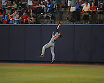 Auburn's Justin Fradejas makes a catch on a ball hit by Mississippi's Zach Miller  during a college baseball game in Oxford, Miss. on Thursday, May 20, 2010.  (AP Photo/Oxford Eagle, Bruce Newman)