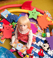 Young Florence Cuthbert isn't quite two, but she was pleased to receive an early birthday present in the shape of a pile of swimming goodies from Computershare Voucher Services.