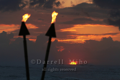 Feb. 17, 2006; Kahuku, Oahu, HI - Tiki torches burn at sunset at the Turtle Bay Resort on the north shore of Oahu...Photo Credit: Darrell Miho.© Darrell Miho