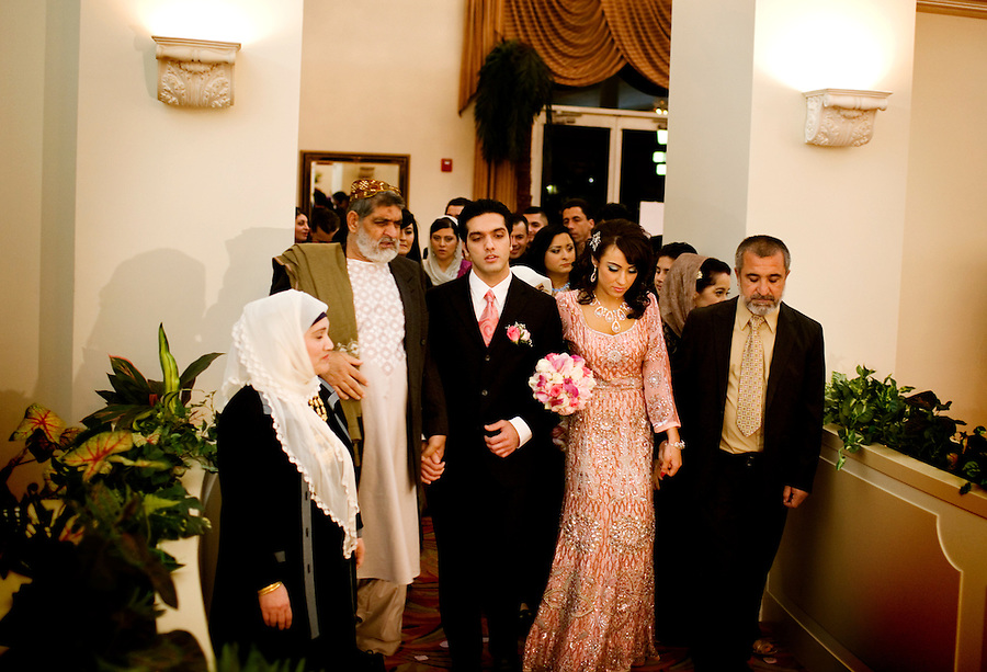 A couple enters their engagement party with their families, at the Diamond Palace, in Fremont, Ca., on Saturday, March 7, 2009.