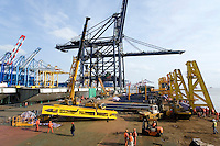Large beams being lifted by crane in steel factory, Changxing Island, Shanghai, China