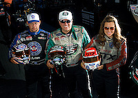 Sept. 19, 2010; Concord, NC, USA; NHRA funny car drivers Robert Hight (left) John Force (center) and Ashley Force Hood pose for a portrait during the O'Reilly Auto Parts NHRA Nationals at zMax Dragway. Mandatory Credit: Mark J. Rebilas-