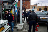 Brooklyn, New York.November 1, 2012..A gas station in Park Slope on 4th Avenue is inundated with drivers looking for gas. Lines stretched for 5 to 10 blocks and drivers waited up to 4 hours to get gas. Police monitor the situation and keep people from cutting the line. ..