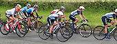 Team GB in one of the trailing groups: Lucy Martin (#3), Nicole Cooke (#1) and Emma Pooley (4).  Olympics 2012.  Women's cycle road race passes along the Shere bypass, the A25, on it's way to Box Hill and then back to the finish in London.