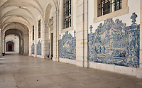 Cloister, with rib vaulted arcade and traditional blue and white azulejos tile scenes of the fables of La Fontaine, 18th century, in the Monastery of Sao Vicente de Fora, an Augustinian order monastery and church built in the 17th century in Mannerist style, Lisbon, Portugal. The monastery also contains the royal pantheon of the Braganza monarchs of Portugal. Picture by Manuel Cohen