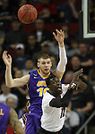 Northern Iowa State's Seth Tuttle (10) slaps the ball away from Louisville's Mangok Mathiang (12) during the 2015 NCAA Division I Men's Basketball Championship's March 22, 2015 at the Key Arena in Seattle, Washington.  Louisville beat Northern Iowa State 66-53 to advance to the Sweet 16.  ©2015. Jim Bryant Photo. ALL RIGHTS RESERVED.