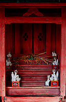 A small inari (fox) shrine in Shimosuwa, Nagano, Japan. Inari shrines are associated with both the harvest and with success in business.