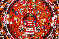 Close up of a colorfull maya sun calendar in mainly reed color, Mexico
