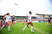 The France and Canada teams run out onto the field. FISU World University Championship Rugby Sevens Women's Cup Final between France and Canada on July 9, 2016 at the Swansea University International Sports Village in Swansea, Wales. Photo by: Patrick Khachfe / Onside Images
