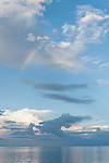Nilandhoo Island, Huvadhoo Atoll, Maldives; cloud formations and a rainbow over the Indian Ocean