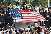 A tattered flag at the Commemoration Ceremony at the National September 11 Memorial at the World Trade Center Site  at the World Trade Center Site in New York, New York on September 11, 2011. .Credit: Kristoffer Tripplaar / Pool via CNP