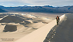 A hiker meets sunrise atop the Eureka Dunes, the tallest and most remote dunefield not only in Death Valley National Park but also California.