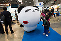 "March 22, 2012, Tokyo, Japan - Two children touch Rico's ""Panda no Tapu Tapu"" character during the Tokyo International Anime Fair. The fair is the world's largest anime event showcasing more than 216 anime-related companies and organizations which includes 89 companies from overseas. (Photo by Christopher Jue/AFLO)"