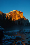 Winter sun setting against El Capitan and reflected in the Merced River.