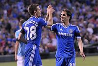 Yossi Benayoun (right) celebates Chelsea's goal scored by Cesar Azpilicueta (28)..Manchester City defeated Chelsea 4-3 in an international friendly at Busch Stadium, St Louis, Missouri.