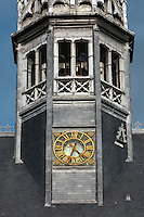 Clock on the spire, built by Guillaume Le Rathe, at the Les Hospices de Beaune, or Hotel-Dieu de Beaune, a charitable almshouse and hospital for the poor, built 1443-57 by Flemish architect Jacques Wiscrer, and founded by Nicolas Rolin, chancellor of Burgundy, and his wife Guigone de Salins, in Beaune, Cote d'Or, Burgundy, France. The buildings, set around an internal courtyard, are in Northern Renaissance and Flamboyant Gothic style, with half-timber galleries, ornate rooftops with Burgundian glazed tiles in geometric patterns and dormer windows. The hospital was run by the nuns of the order of Les Soeurs Hospitalieres de Beaune, and remained a hospital until the 1970s. The building now houses the Musee de l'Histoire de la Medecine, or Museum of the History of Medicine, and is listed as a historic monument. Picture by Manuel Cohen