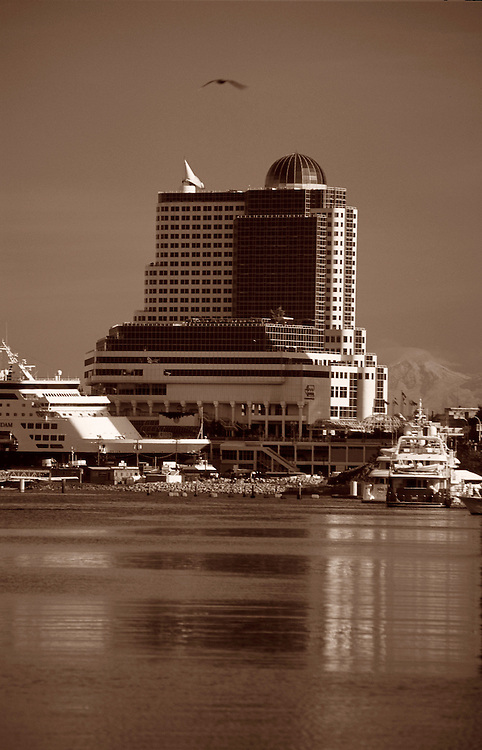 Canada Place, ships and marina of Coal Harbor, with Mount Baker in distance, from Stanley Park seawall, Vancouver, BC.