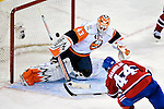 26 October 2009: New York Islanders' goaltender Martin Biron gives up the game winning goal in overtime to Montreal Canadiens defenseman Roman Hamrlik at the Bell Centre in Montreal, Quebec, Canada. The Canadiens defeated the Islanders 3-2 in sudden death overtime for their 4th consecutive win. Mandatory Credit: Ed Wolfstein Photo