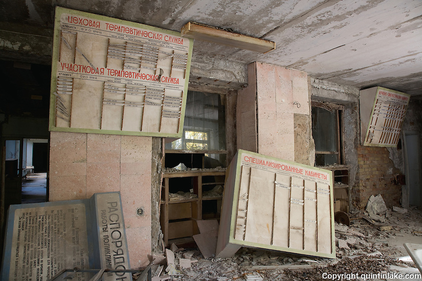 Hospital reception with doctor's appointment boards.<br />