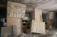 Hospital reception with doctor's appointment boards.<br /> <br /> Pripyat (Pripiat), 1km from the reactor, was designed as an exemplar of Soviet planning for the 50,000 people who worked at the Chernobyl Nuclear Power Plant in 1986 the result was the worst nuclear accident in history. Now a ghost town in Ukraine, Pripyat is in a radioactive exclusion zone unfit for human habitation for hundreds of years. This image was taken in 2007 over 5 hours, apparently the safe period of exposure.<br /> <br /> This image was exhibited at the Architectural Association, London in the exhibition &quot;Pripyat: 21 Years After Chernobyl, photographs by Quintin Lake&quot; 2008