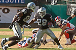 Oakland Raiders running back Amos Zereoue (28) on Sunday, September 19, 2004, in Oakland, California. The Raiders defeated the Bills 13-10.