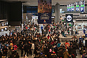March 20, 2011, Chiba, Japan - Passengers crowd as they wait to check in to a flight at Narita International Airport, east of Tokyo. Foreign governments has posted advisories to foreign residents in Tokyo to depart the country as Japan continues to battle the nuclear crisis of the quake-hit nuclear plant in Fukushima.