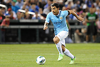Carlos Tevez (32) Manchester City drives at the Chelsea goal..Manchester City defeated Chelsea 4-3 in an international friendly at Busch Stadium, St Louis, Missouri.